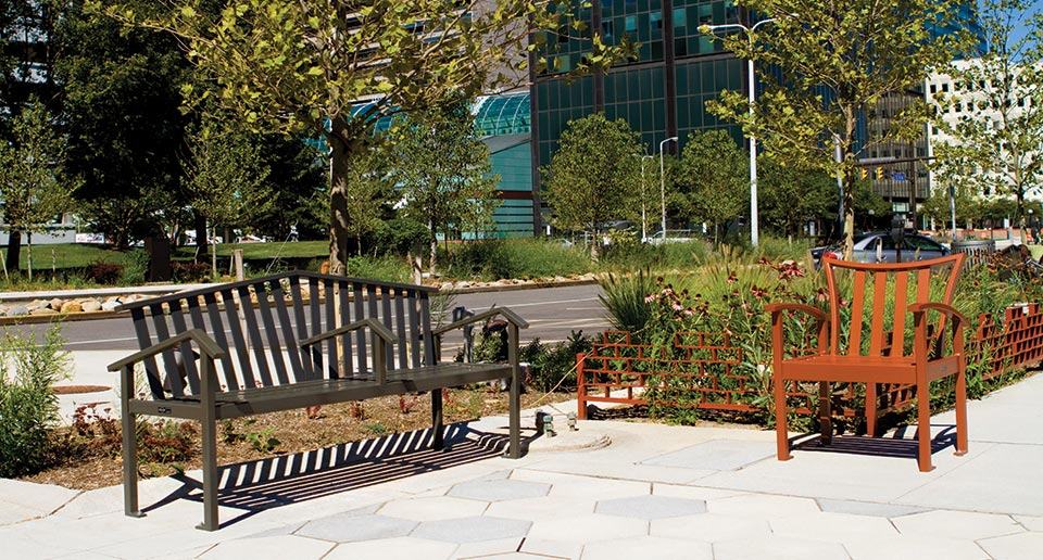 Atticus Bench with Back and Exeter Chair in an urban setting