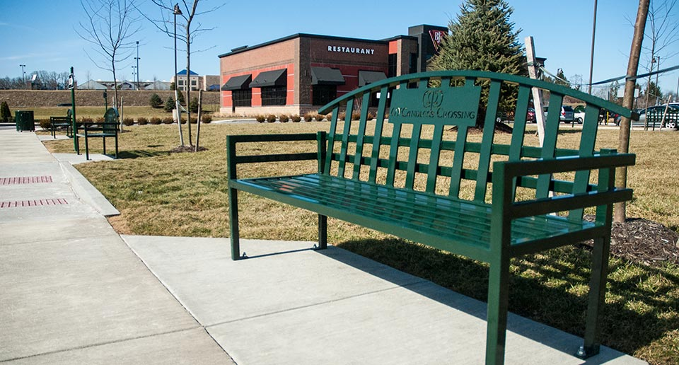 Branded McConnell Bench with Back at outdoor shopping complex