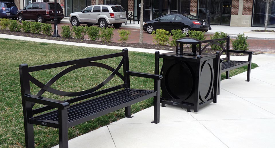 Yuma Benches with Back and coordinating Litter Receptacle in a commercial retail space