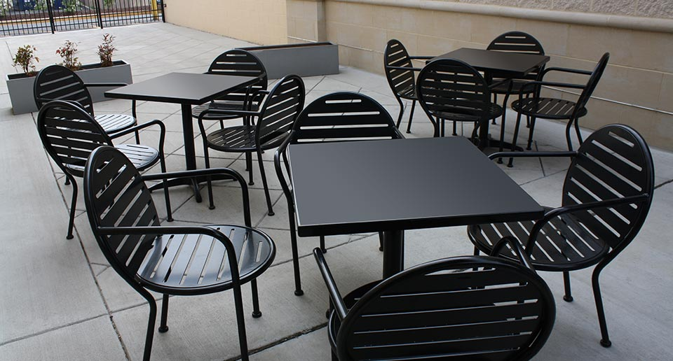 Olivia Table Sets in an outdoor restaurant seating space