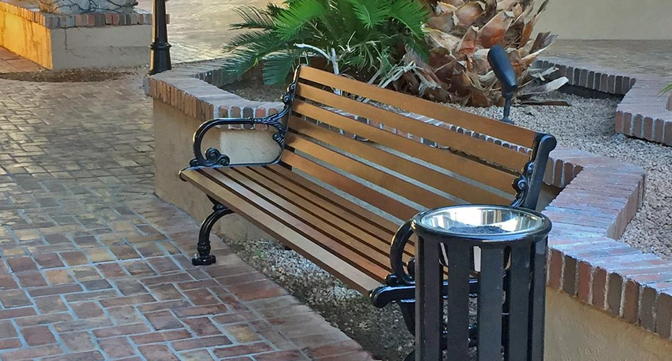 Rosedale Bench with Back and Reading Ash Urn in a small shopping complex