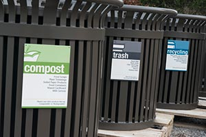 Midtown receptacles with trash, recycling, and compost sorting signage